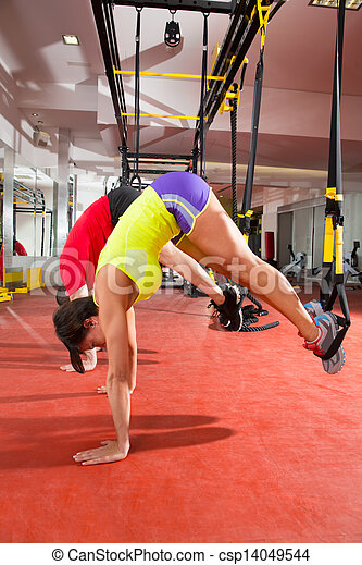 Fitness TRX training exercises at gym woman and man - csp14049544