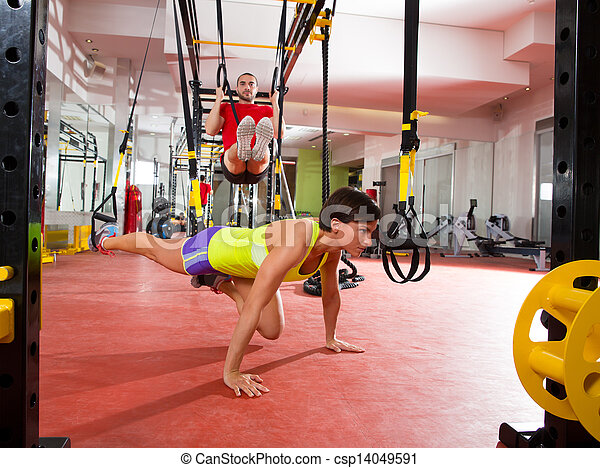 Fitness TRX training exercises at gym woman and man - csp14049591