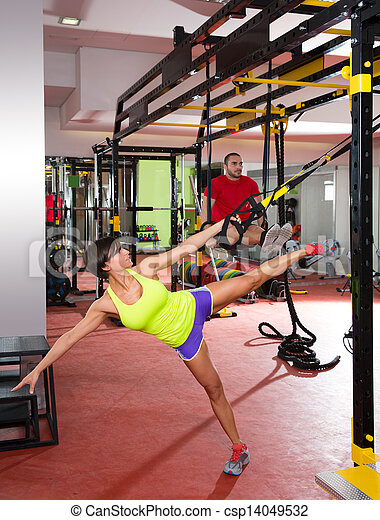 Fitness TRX training exercises at gym woman and man - csp14049532