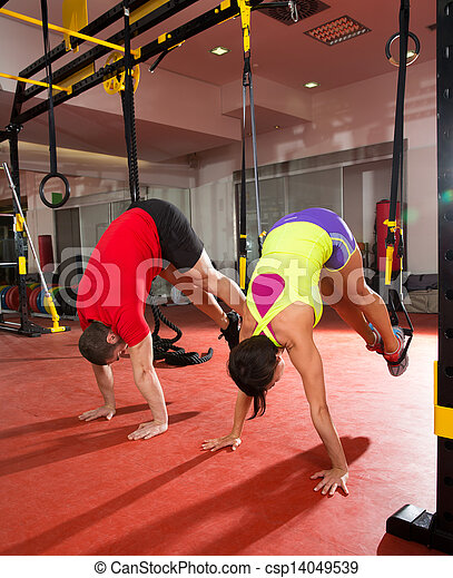 Fitness TRX training exercises at gym woman and man - csp14049539