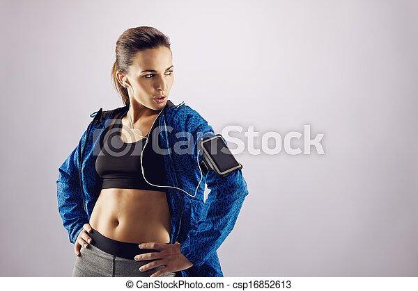 c106da5b Fitness woman in sportswear looking away at copyspace. Portrait of ...