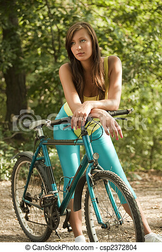fitness Woman with bike - csp2372804
