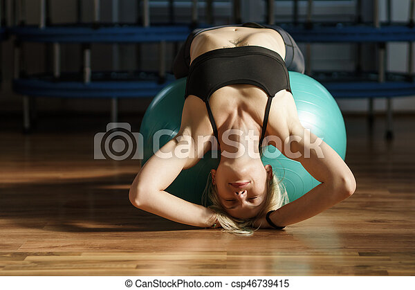 Fitness woman with gym ball - csp46739415