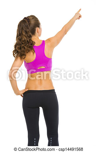 Fitness young woman pointing on copy space . rear view - csp14491568