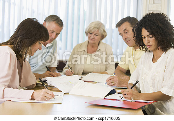 Five adult students studying at table (depth of field) - csp1718005