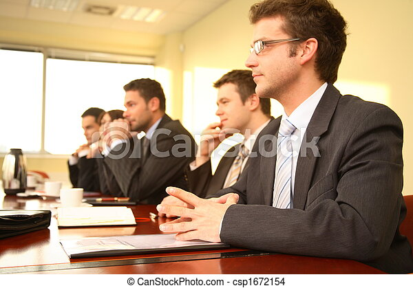 Five business persons at a Conference - csp1672154