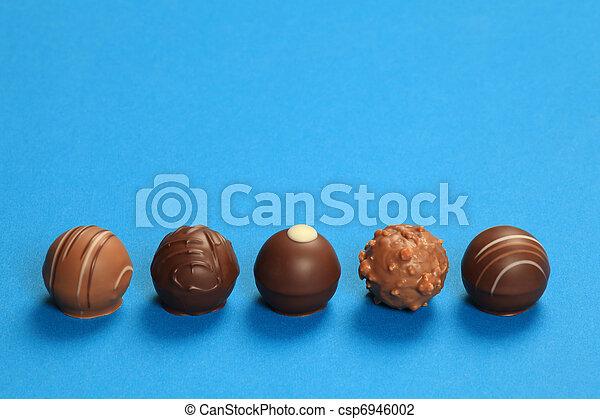Five chocolate truffles in a row - csp6946002