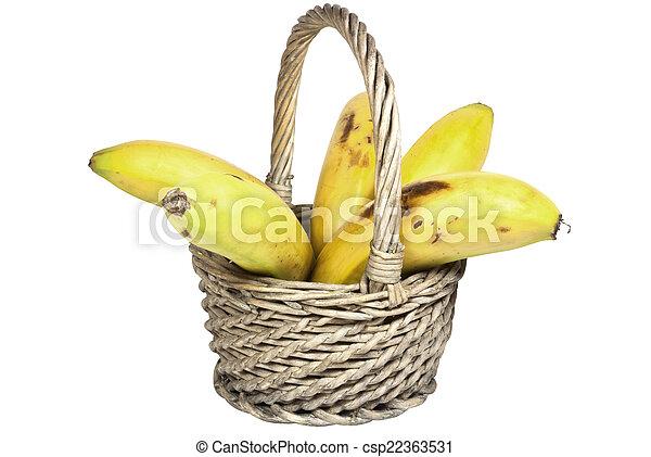 Five Ripe Bananas in a Woven Wicker Basket - csp22363531