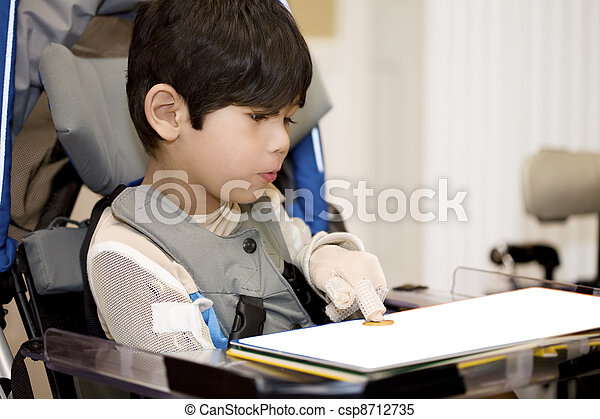 Five year old disabled boy studying in wheelchair - csp8712735