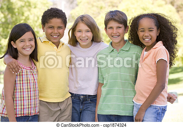 Five young friends standing outdoors smiling - csp1874324
