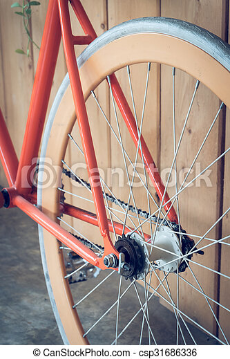 fixed gear bicycle parked with wood wall - csp31686336