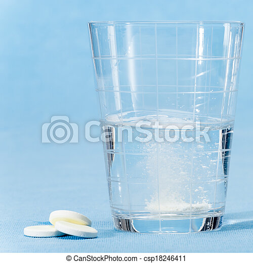 Fizzy vitamin capsule throw in water glass - csp18246411