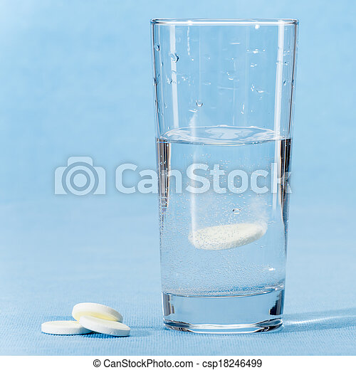 Fizzy vitamin capsule throw in water glass - csp18246499