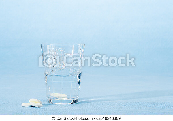 Fizzy vitamin capsule throw in water glass - csp18246309