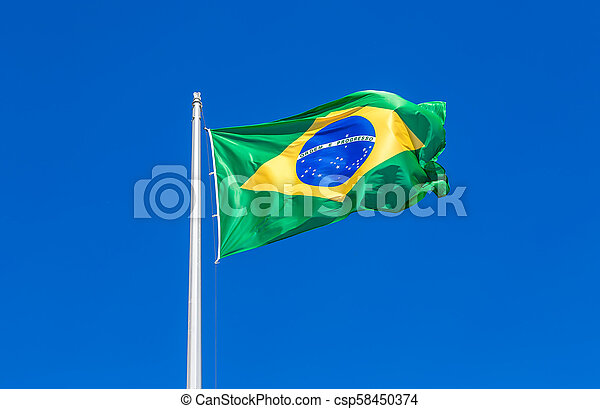Flag of Brazil flying in the wind against the sky - csp58450374
