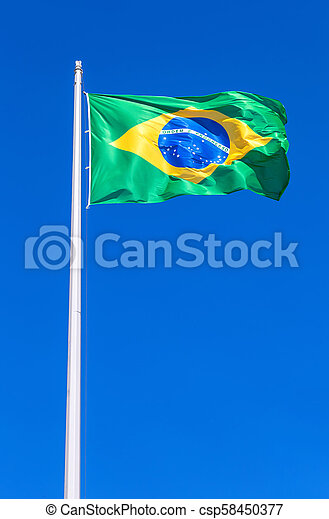 Flag of Brazil flying in the wind against the sky - csp58450377