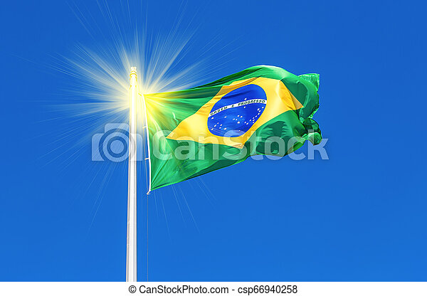 Flag of Brazil flying in the wind against the sky - csp66940258