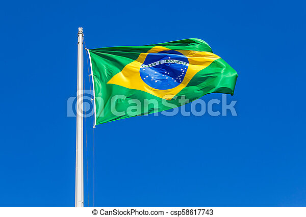 Flag of Brazil waving in the wind against the sky - csp58617743