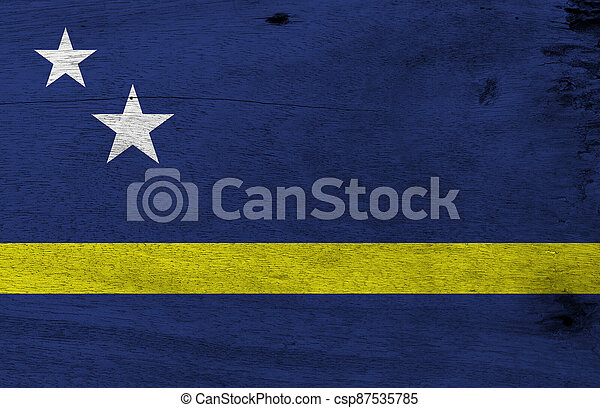 Flag of Curacao on wooden plate background. Grunge Curacao flag texture, blue field with a horizontal yellow stripe slightly below the midline and two white stars. - csp87535785
