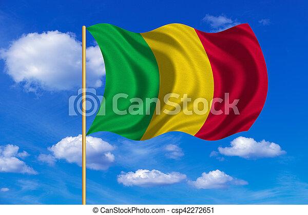 Flag of Mali waving on blue sky background - csp42272651