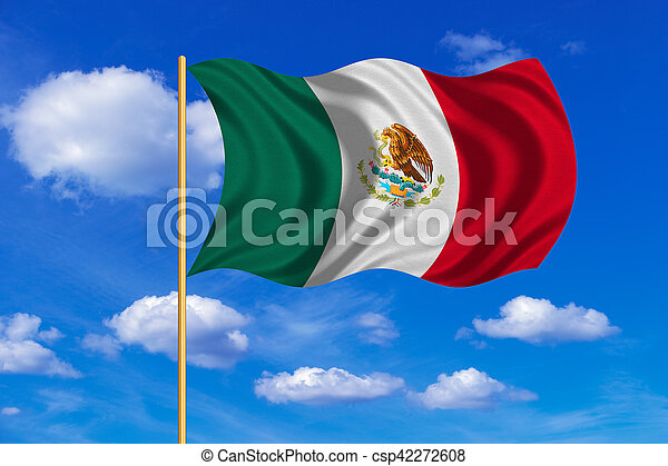 Flag of Mexico waving on blue sky background - csp42272608