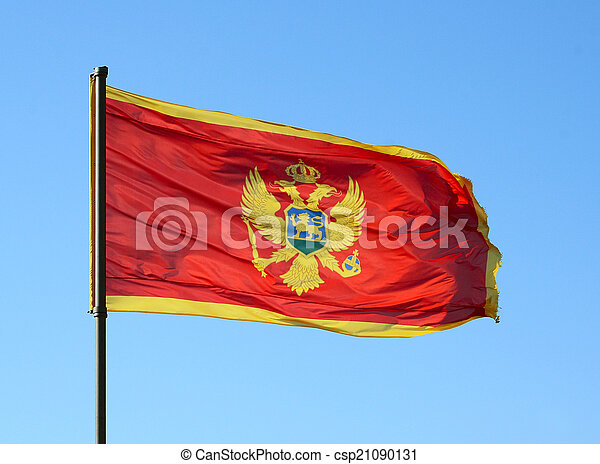 Flag of Montenegro on a blue sky - csp21090131
