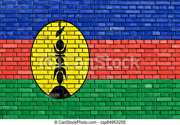flag of New Caledonia painted on brick wall - csp84953258