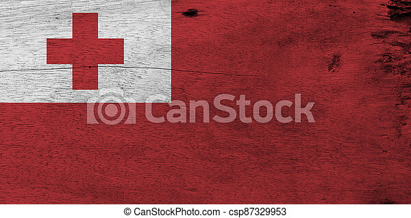 Flag of Tonga on wooden plate background. Grunge Tongan flag texture, A red field with the white rectangle on the upper hoist-side corner bearing the red Greek Cross. - csp87329953