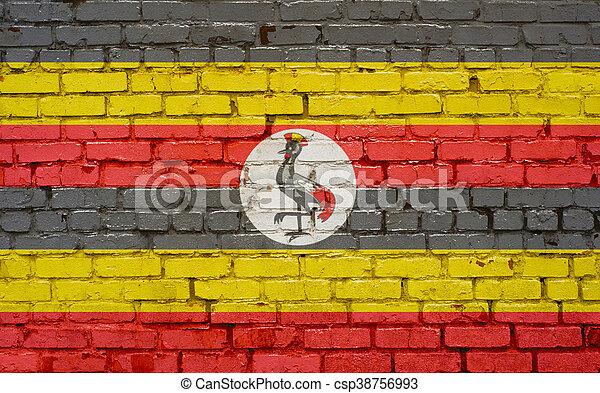 Flag of Uganda painted on brick wall, background texture - csp38756993