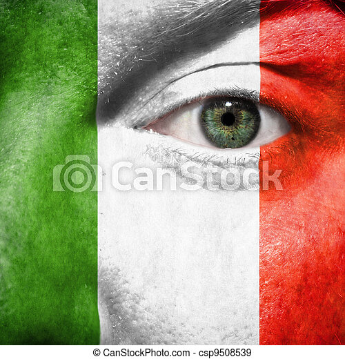 Flag painted on face with green eye to show Italy support in sport matches - csp9508539