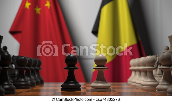 Flags of China and Belgium behind pawns on the chessboard. Chess game or political rivalry related 3D rendering - csp74302276