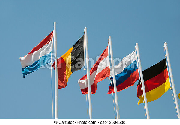 Flags of different countries on a background of blue sky - csp12604588