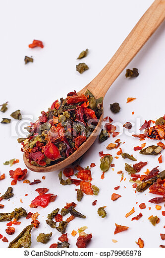 Flakes of red and green pepper. - csp79965976