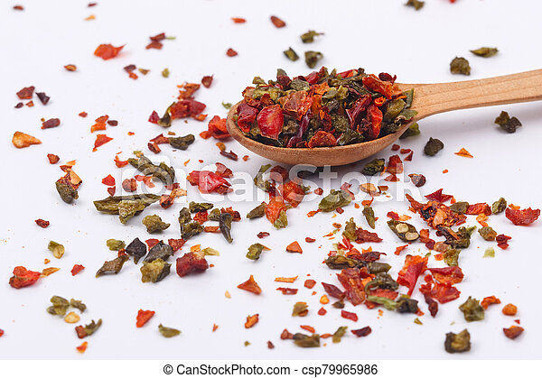 Flakes of red and green pepper. - csp79965986