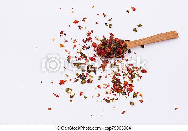 Flakes of red and green pepper. - csp79965964
