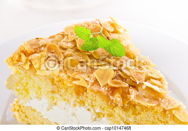 flat cake with an almond and sugar coating and a custard or cream filling - csp10147468