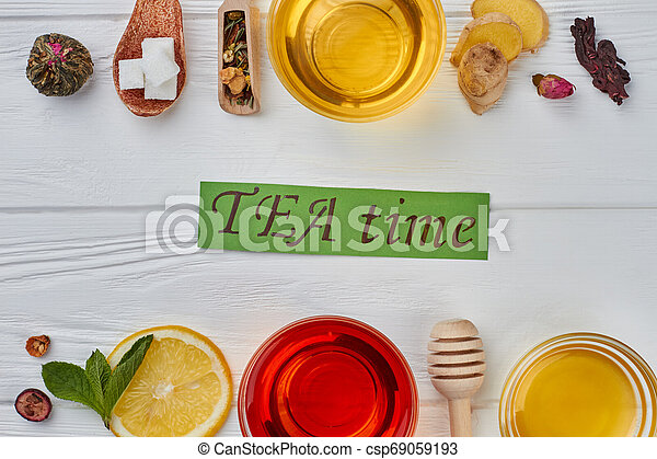 Flat lay healthy tea composition on wooden background. - csp69059193