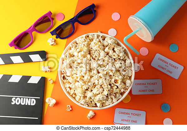 Flat lay. Movie watch accessories on two tone background, top view - csp72444988