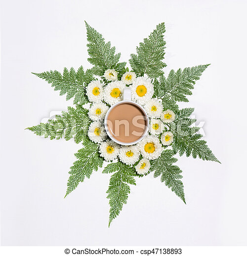 Flat lay of green leaves and flowers pattern with cup of coffee on white background - csp47138893