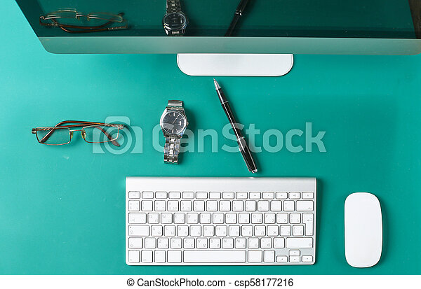 Flat lay photo of office desk with keyboard, notebook, tablet, smartphone, eyeglasses - csp58177216