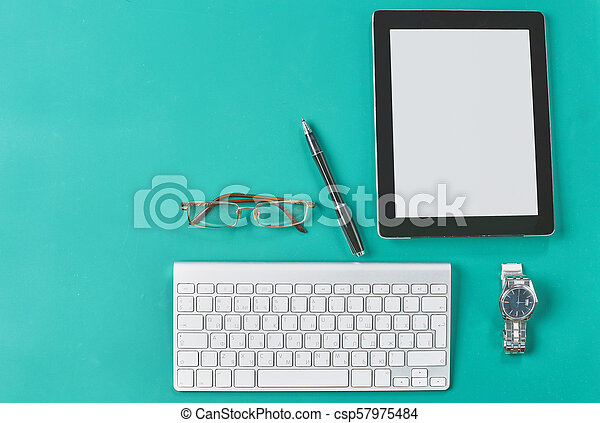Flat lay photo of office desk with keyboard, notebook, tablet, smartphone, eyeglasses - csp57975484