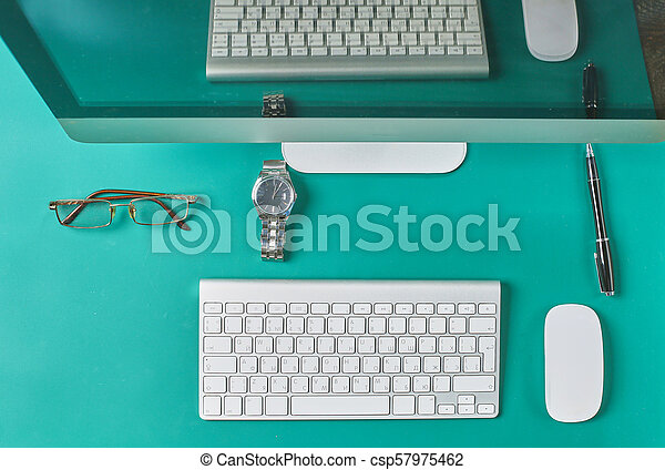 Flat lay photo of office desk with keyboard, notebook, tablet, smartphone, eyeglasses - csp57975462