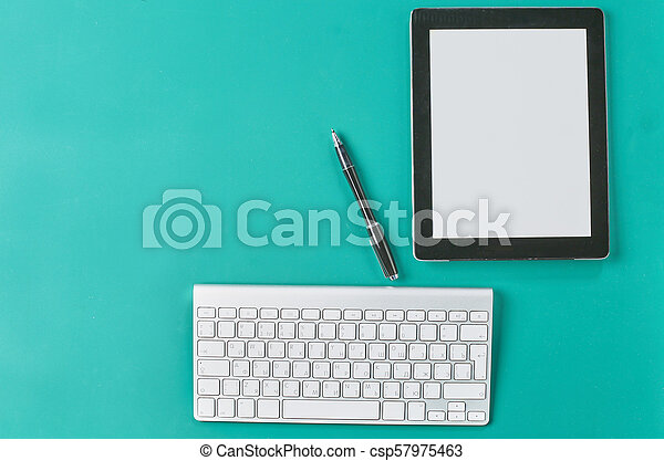 Flat lay photo of office desk with keyboard, notebook, tablet, smartphone, eyeglasses - csp57975463