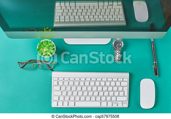 Flat lay photo of office desk with keyboard, notebook, tablet, smartphone, eyeglasses - csp57975508