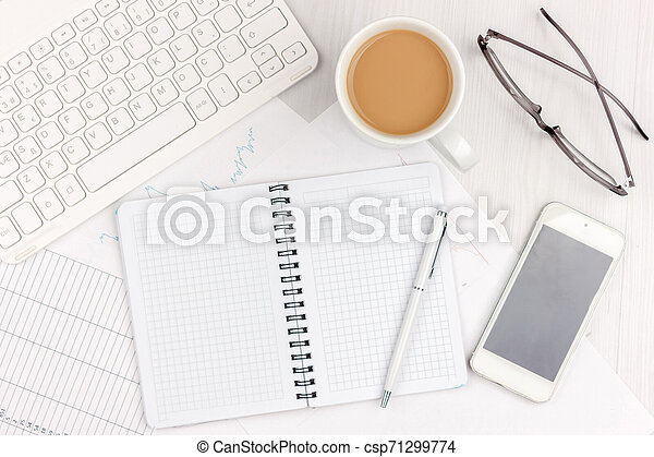 Flat lay photo of white office desk with laptop, smartphone, eyeglasses, notebook and pen with copy space background. Mockup - csp71299774