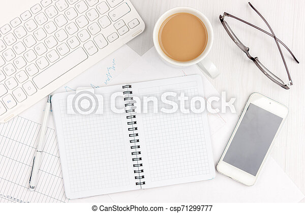 Flat lay photo of white office desk with laptop, smartphone, eyeglasses, notebook and pen with copy space background. Mockup - csp71299777