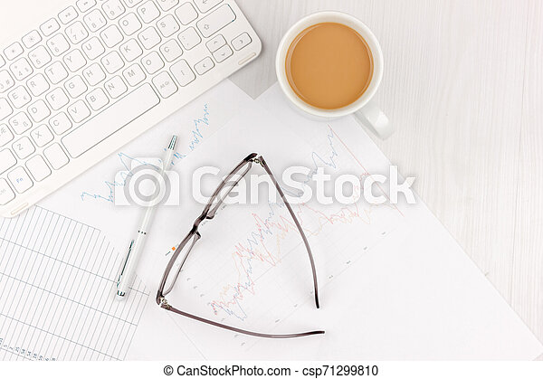 Flat lay photo of white office desk with laptop, smartphone, eyeglasses, notebook and pen with copy space background. Mockup - csp71299810