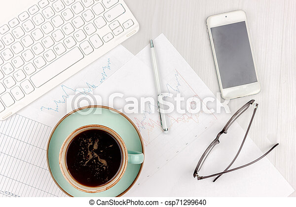 Flat lay photo of white office desk with laptop, smartphone, eyeglasses, notebook and pen with copy space background. Mockup - csp71299640