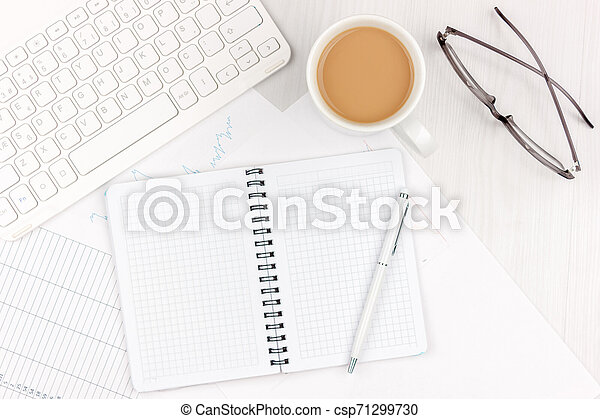 Flat lay photo of white office desk with laptop, smartphone, eyeglasses, notebook and pen with copy space background. Mockup - csp71299730