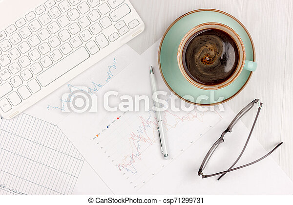 Flat lay photo of white office desk with laptop, smartphone, eyeglasses, notebook and pen with copy space background. Mockup - csp71299731